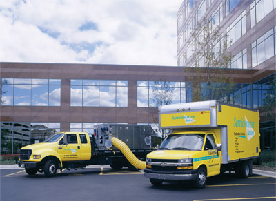servicemaster-trucks-for-water-extraction-at-dallas-office-building