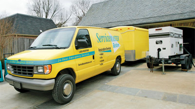 servicemaster_dallas_truck_with_dehumidifiers_for_water_damage